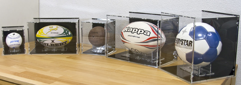 Several Sports Ball Display Cases